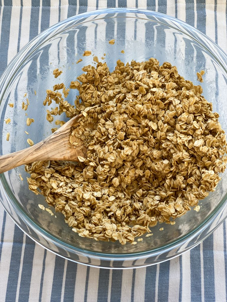 bowl of oats honey butter mixed together to make granola