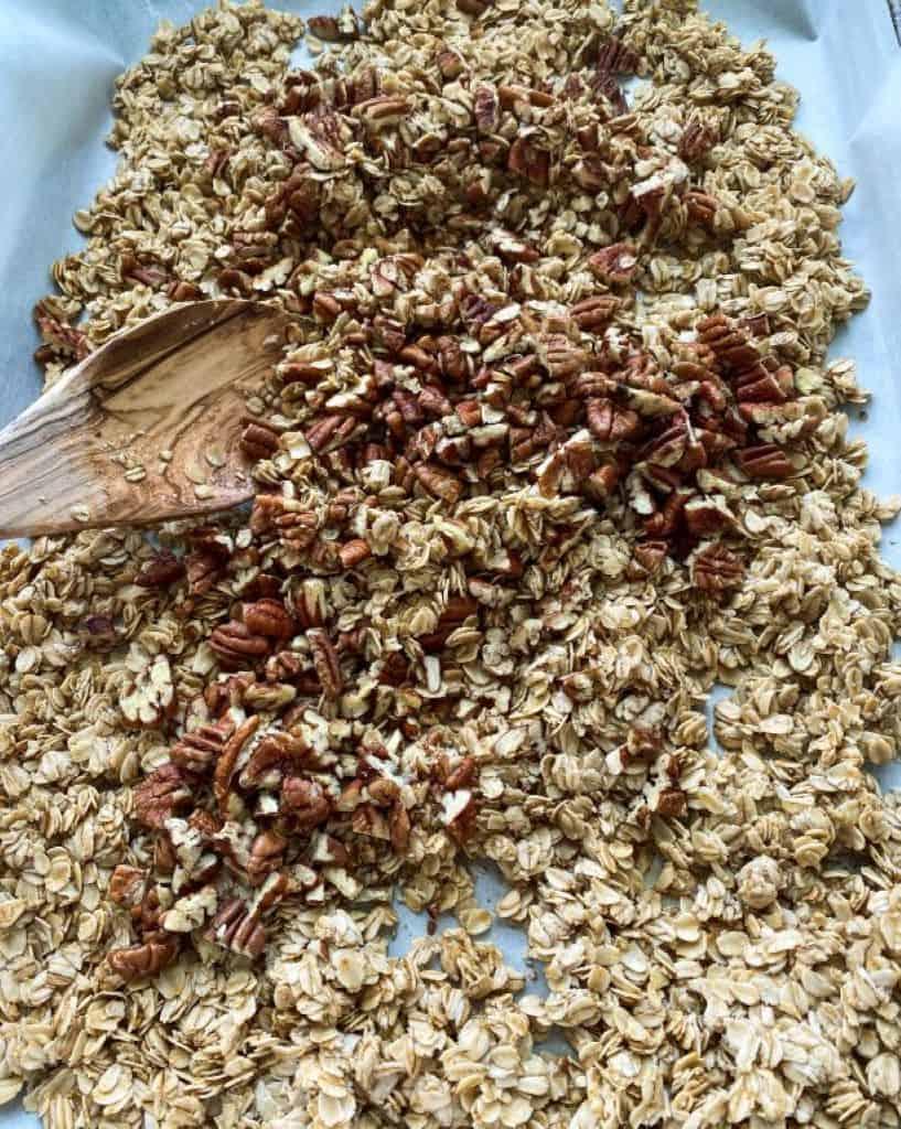 pan of oats honey nuts mixed to make granola