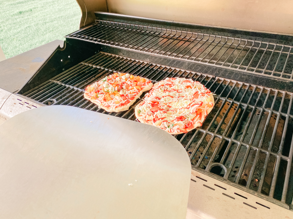 how to cook pizza on the grill pizza paddle peel barbecue bbq grilled cooked crust