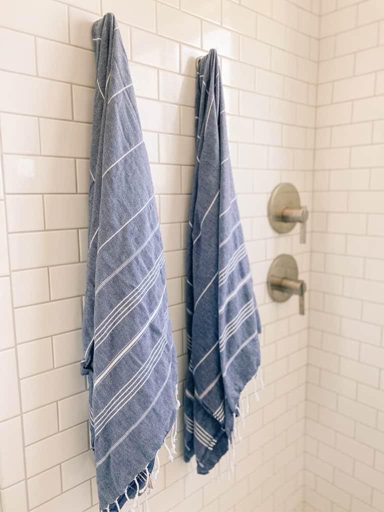 turkish peshtemal shower hang towel hook faucet white subway tile