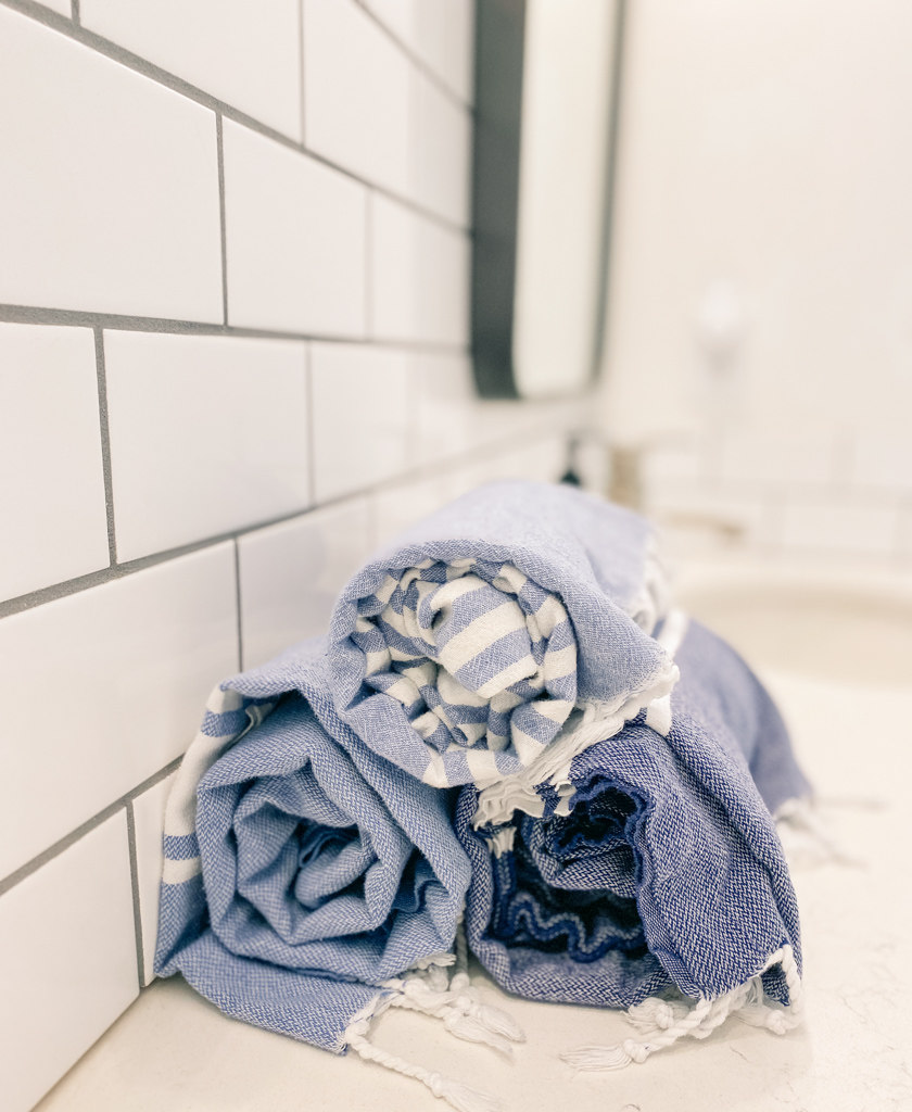 turkish peshtemal towels rolled stacked bathroom counter